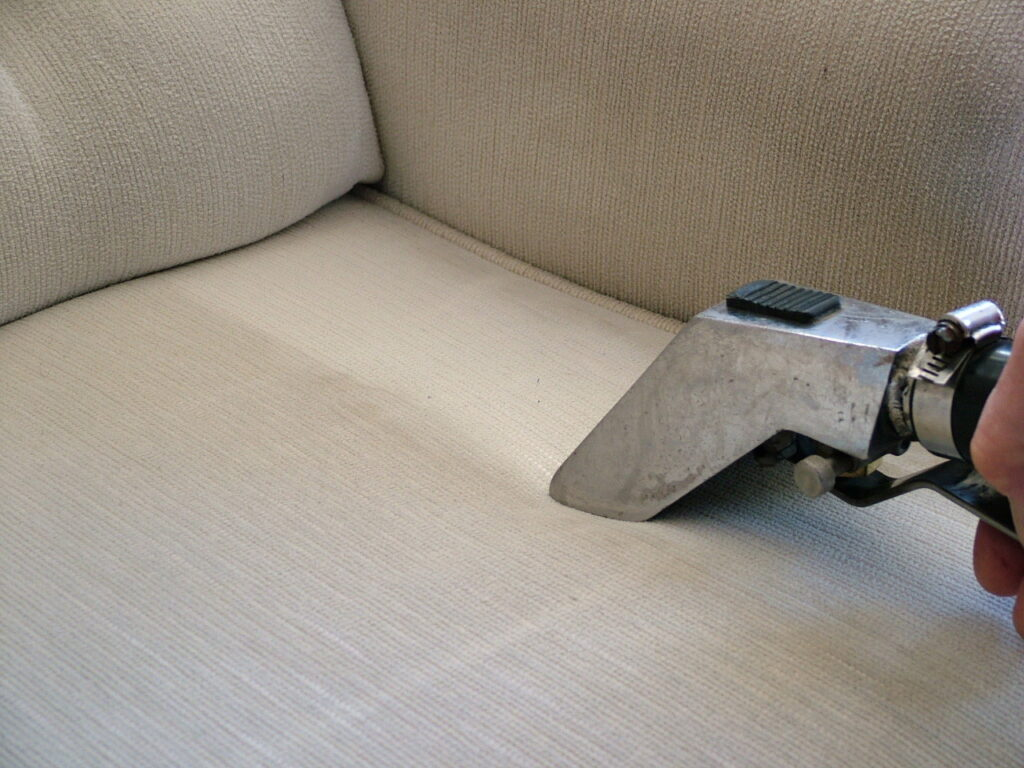 Cleaning Sofa with Cleaning equipment and showing difference between clean and unclean