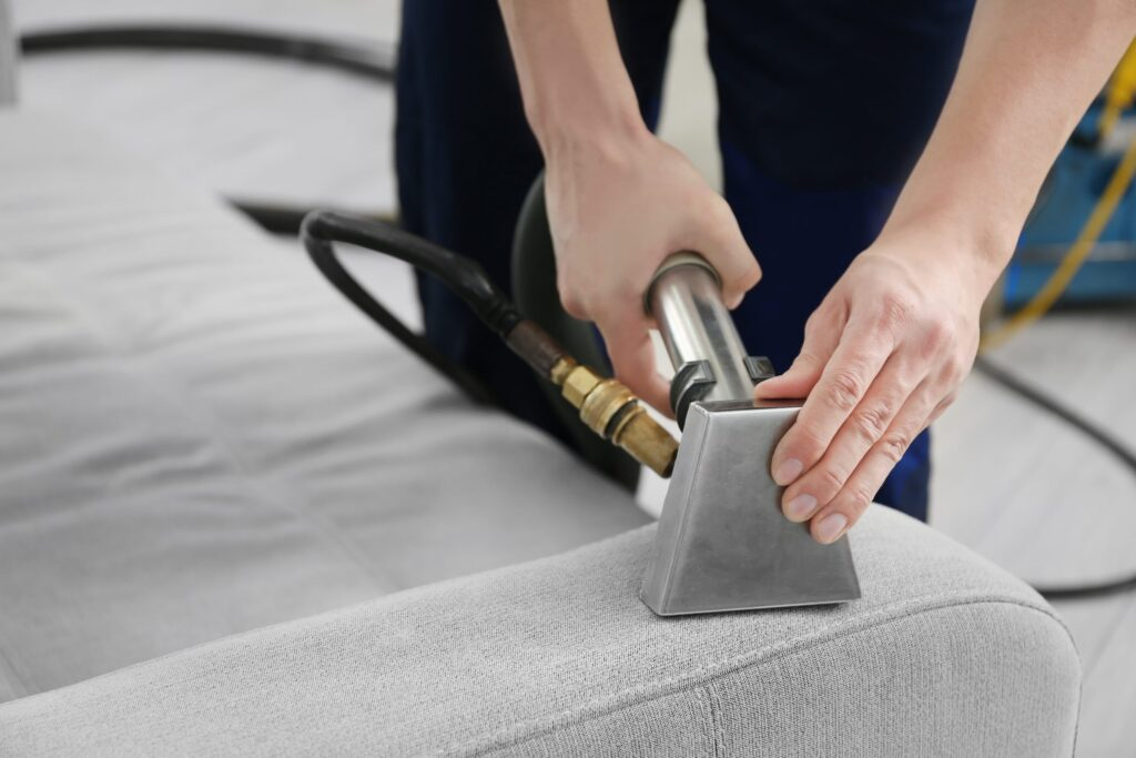 cleaning sofa cushion with steam cleaning machine