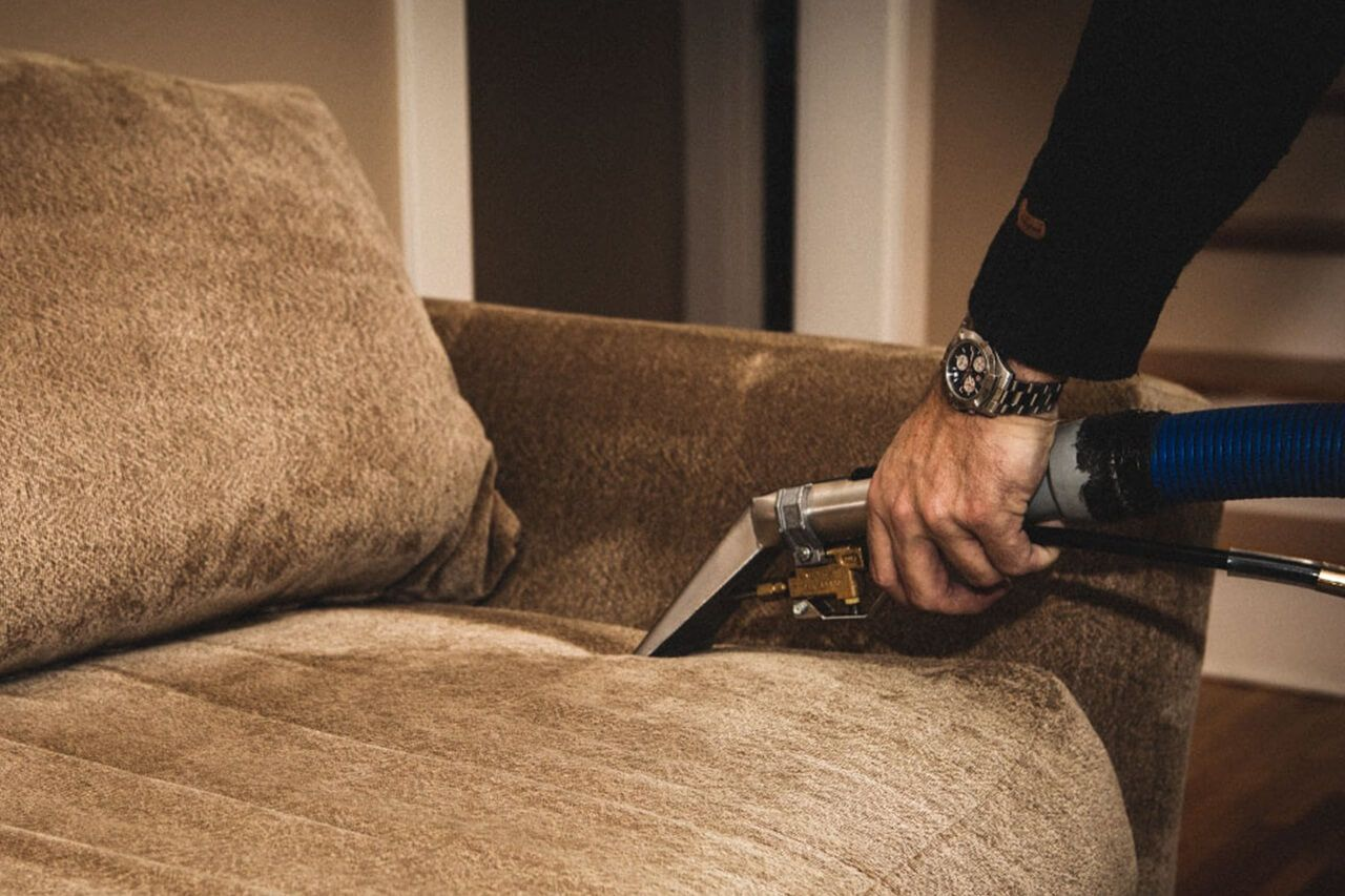 brown couch cleaning with cleaning equipment